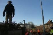 An activist surveys the contractors