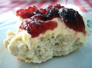A scone with clotted cream and jam by Su-Lin Creative Commons Licence