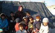 Maya with refugee children