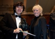 Tae Hyung-Kim receives his prize from Petula Clark - photograph courtesy of Hastings International Piano Concerto Competition
