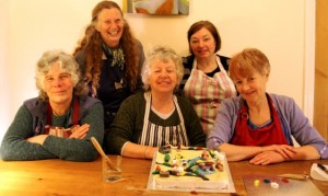Granny Action with cake for Transport Minister