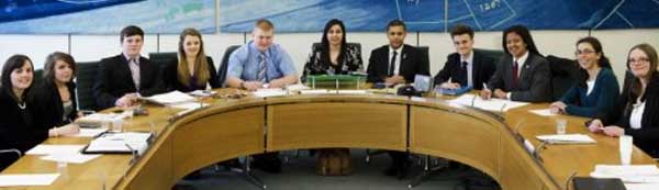 Solomon Curtis (third from right) taking his seat on the Youth Select Committee 2013.