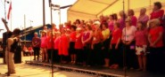 Sound Waves Community Choir singing at the Stade