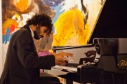 2012 winner Eugenio Catone of Italy plays Schubert's Sonata D664 at Jerwood Gallery, Hastings, November 2012. In the background is a painting by Gillian Ayres. Photo © Alexander Brattell.