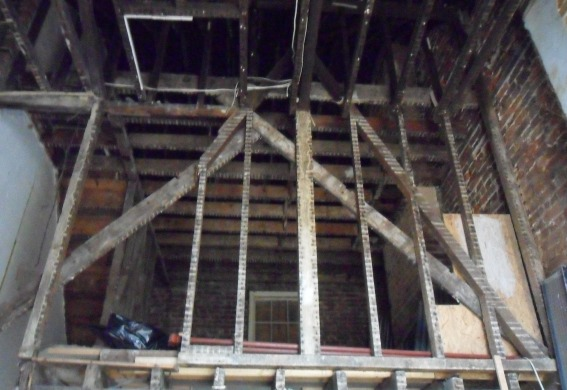 Inside existing building with the original poor timber structure being gradually removed.