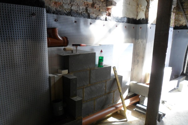 150mm of insulation and tanking membrane to existing wall.
