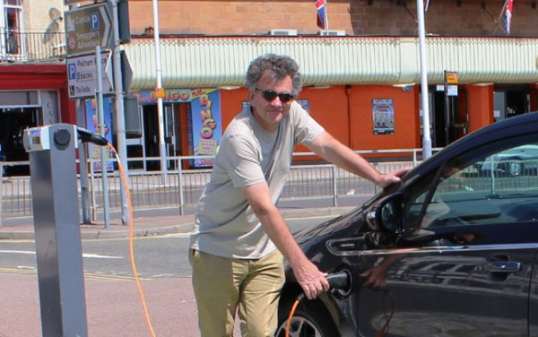 New council leader Peter Chowney promoting an electric car charging point on the sea-front last year (photo: HBC).