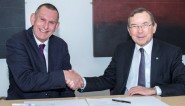 Council leader Jeremy Birch, left, signing an agreement in March with Prof Julian Crampton, vice-chancellor of the University of Brighton (photo: HBC).