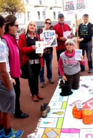 Julia Dance leads a game of pavement monopoly to illustrate the dangers of TTIP (photo: Lesley Shareif).