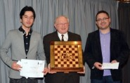Winner's cheques were presented to Jahongir Vakhidov (left) and Alexander Mista (right) by congress director Alan Hustwayte, who holds the Golombek trophy (photo: Pam Thomas).