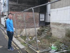 Simon Duncan, who lives across the street, surveys the future construction site.