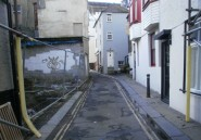 West Street, Old Town: the council's planning committee has given the go-ahead for new buildings on the site to the left, ignoring the detrimental effect these will have on the privacy and daylight available to the properties across the narrow street, which is just 3.6 metres wide.