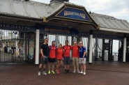 Starting point: Daniel, third from right, with family and friends outside Brighton pier.