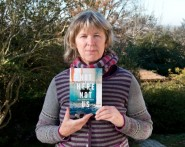 Bronwen Griffiths with her book, Not Here, Not Us.