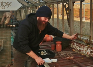 Blacksmith Tobias Cobrin checks the cast iron work which his company will restore.