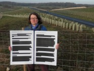 Down by the link road, CHD's andrea Needham displays a copy of the redacted report. All has now been made clear.