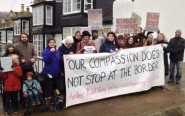 Protesters outside Home Secretary Amber Rudd's house demand justice for child refugees (photo: Peace News).