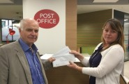 Message from St Leonards: Patrick Glass hands over copies of 450 protest letters from local residents to the PO's Laura Tarling.