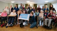 Dementia Drawing group: participants, carers, teachers, family and, in boater, life model.