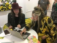 Hastings Creatives web developer Jon Ingram helps Juliet Russell sign up