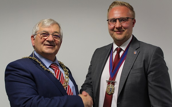 Hastings' new mayor, Cllr Nigel Sinden, left, shakes hands with his deputy, Cllr James Bacon.
