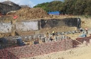 Walls are rising on the site behind the listed buildings off West Hill Road.