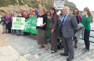 Handover of Green Party petition on the harbour proposal to mayor Nigel Sinden, right, by Julia Hilton, centre, and Amelia Womack, the Greens' deputy leader.