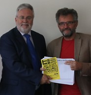 Dr David Warden accepting the 4000 strong petition from Peter Chowney, Labour Party Parliamentary Candidate