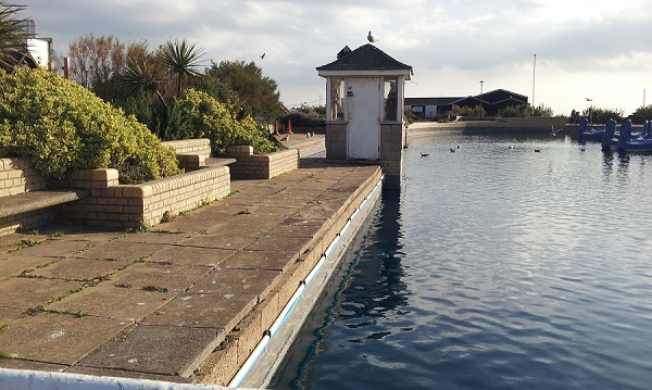 The amusement park owner plans to build a new footpath alongside the boating lake.