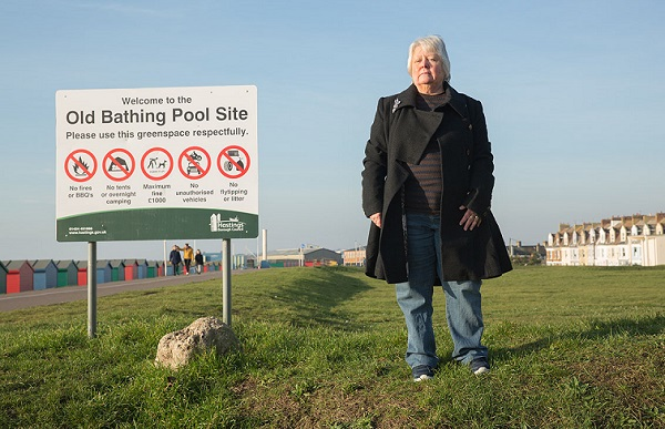 Virginia Vilela of the West Marina residents' group at the old bathing pool site where a development of 152 dwellings is proposed.