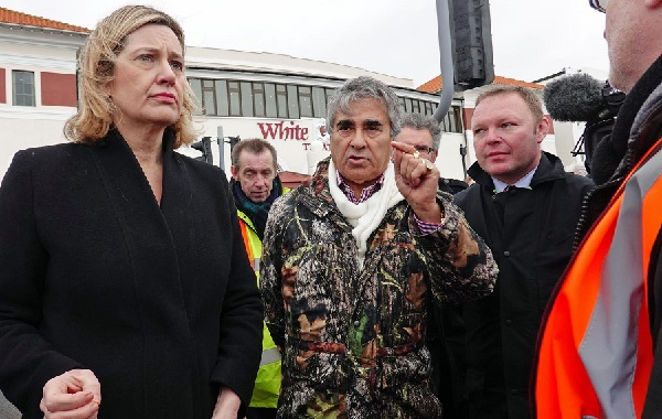 Mr Gulzar makes a point on the occasion of the Queue protest, flanked by MP Amber Rudd and right-hand man, or in this case left-hand man, Brett Maclean.