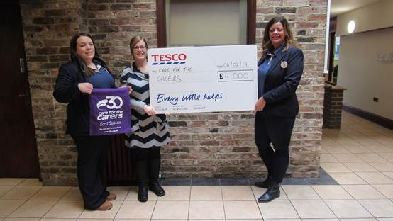CFTC Director of Services, Jo Egan receiving prize from Tesco Community Champion, Coo Buckley (right) and colleague Kim Smith (left).