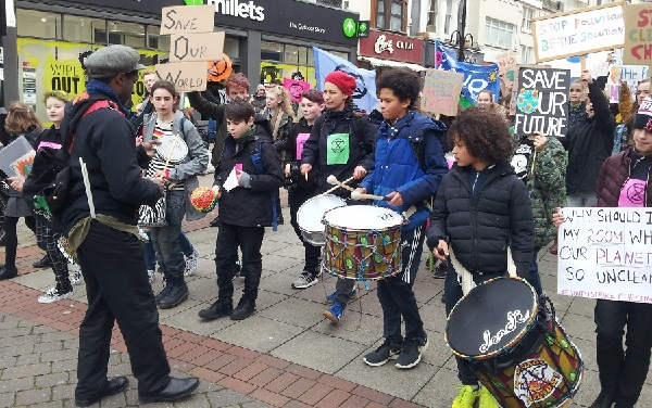 School students on climate strike processed through the town centre led by a drumming band.