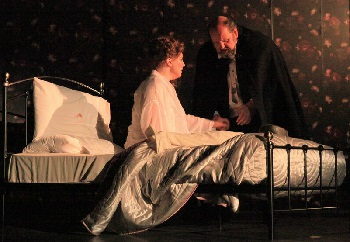 Violetta on her death bed, attended by the trusty Dr Grenville ().