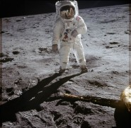 Buzz Aldrin on Moon with reflection in helmet.