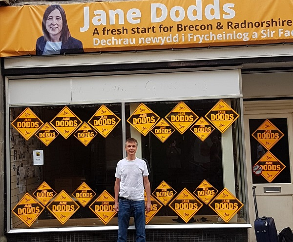 Local LibDem member George Goring outside party headquarters in Brecon on the morning after byelection victory.