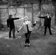 "A Question of Honour © Ken Russell/TopFoto January 1955 From a series: ""The last of the Teddy Girls"" 16 year old Eileen from Bethnal Green, with two teddy boys ""duelling"" over her on an East End bombsite."