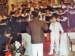Marcio sings solo with choir
