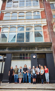 Teams from Heart of Hastings CLT and Project Artworks, standing outside 12 Claremont, Hastings, their latest project gifted to them as a community asset transfer from East Sussex County Council. Photo Jonny Thompson