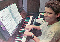 Young Marcio at the piano
