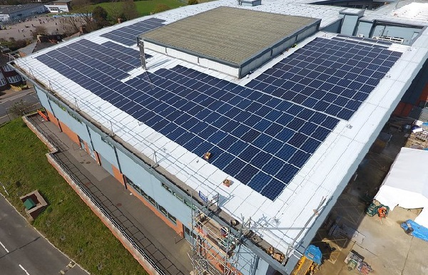 Installation of solar panels on the roof of Ore College, another ESC project backed by community shares (photo: ESC).