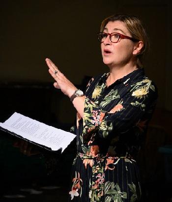Rachel McCarron plays both Petra and Angie.