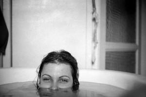 ALINE in her mother's bath in Paris © Bob Mazzer