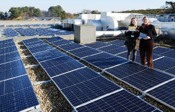 Kate Meakin and eco-activist Julia Hilton amid a myriad solar panels on the roof of Hastings Academy (photo: ESC).