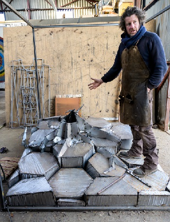 Sculptor Leigh Dyer demonstrates progress with the set (photo: Peter Mould).