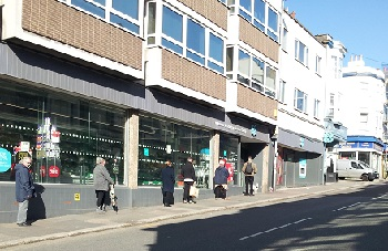 Queues also outside the Coop in St Leonards which, like many food retailers, is limiting the numbers allowed inside.