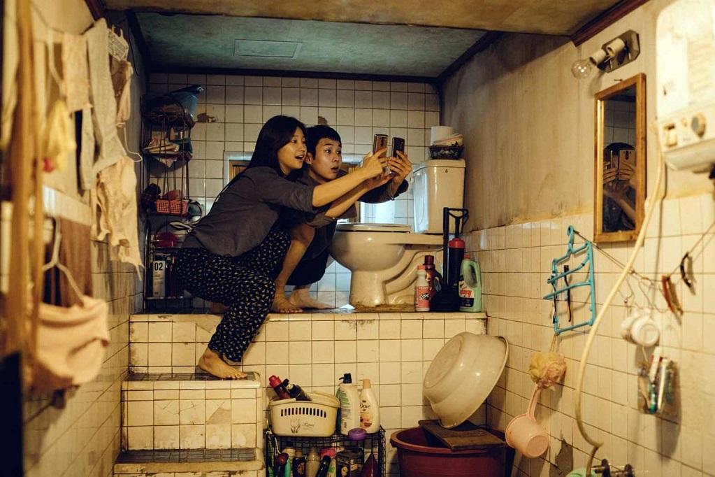 Two people looking at phones in bathroom