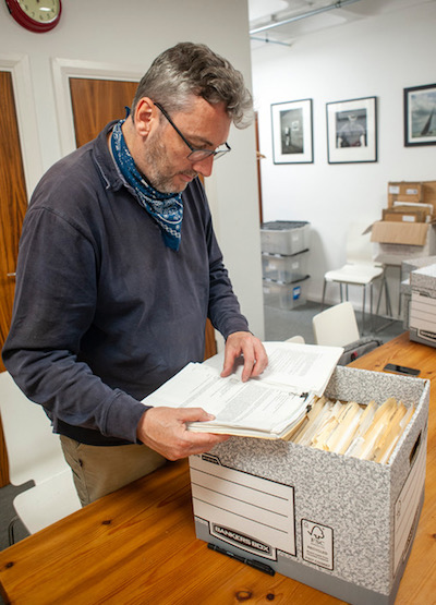 Jonathan Pledge, Curator of Politics and Public Life at The British Library, reviews the contents of one of the 36 boxes of materials belonging to the Kim Stallwood Archive. Photo credit: John Cole