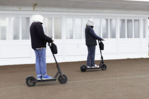 Electric scooters riding shotgun on pavement © Russell Jacobs