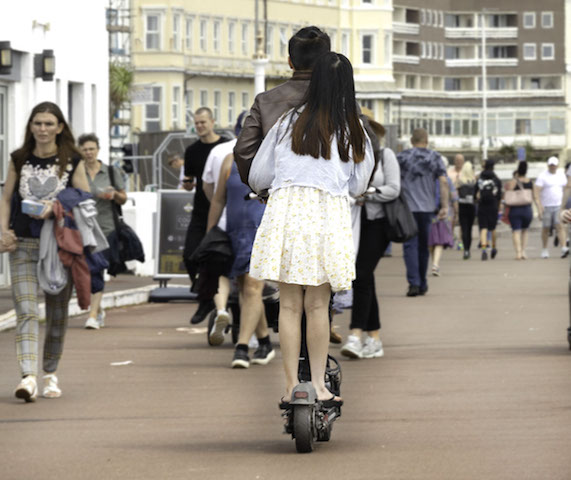 Electric scooters riding shotgun on promenade © Russell Jacobs